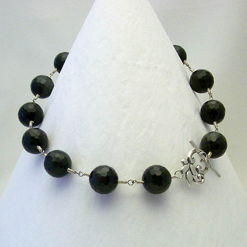 Rainbow Obsidian Necklace w/ a Sterling Silver Flower Clasp